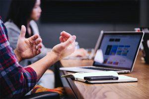 man gesturing in a meeting