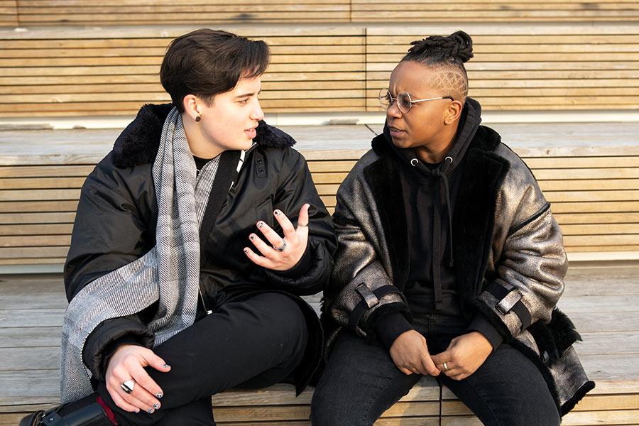 people sitting outside talking