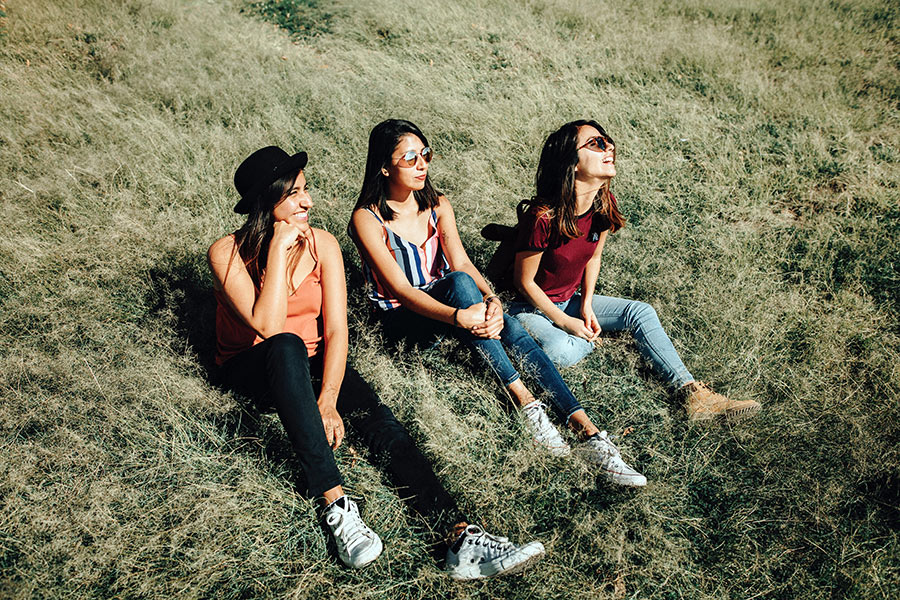 teens sitting in a field